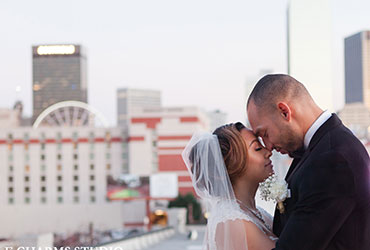 Photo of bride and groom on top of Terminus 330 with gorgeous view of Atlanta